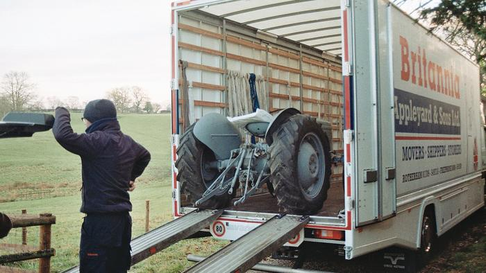Loading furniture and Massey Ferguson grey tractor /Moving to France from Manchester