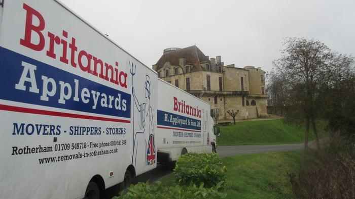 Removal van from Yorkshire parked outside a French chateau